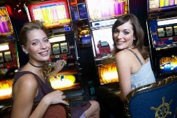 Girls playing at slot machines