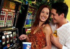Couple playing at slot machines